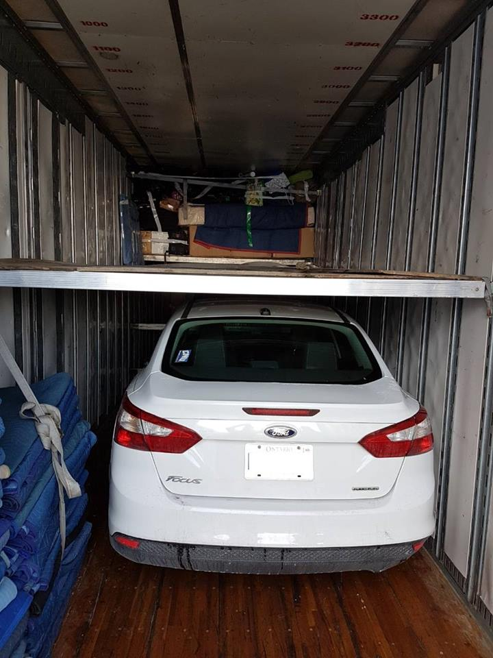 Two story trailer for vehicle and household stuff moving.